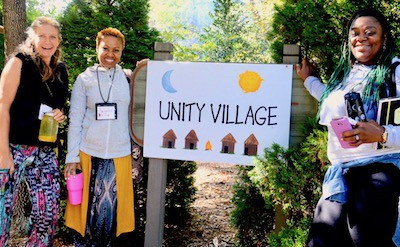 act 2018 KP unity village sign